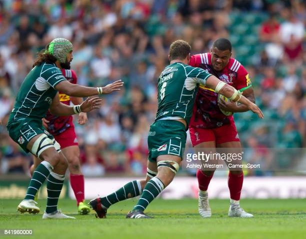 Harlequins' Kyle Sinckler is tackled by London Irish's Mike Coman during the Aviva Premiership match between London Irish and Harlequins at...