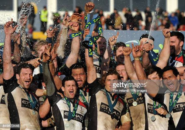 Harlequins' Luke Wallace lifts the trophy following Harlequins' victory over Sale Sharks in the LV=Cup Final at Sixways Stadium Worcester