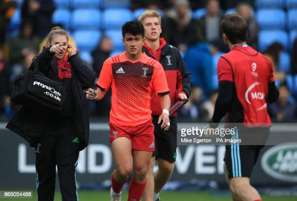 Harlequins' Marcus Smith leaves the field during the warm up with a cut to his forehead during the Champions Cup pool one match at the Ricoh Arena...