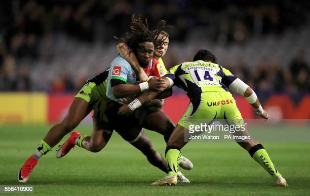 Harlequins' Marland Yarde is tacked by Sale Sharks' Denny Solomonia during the Aviva Premiership match at Twickenham Stoop London