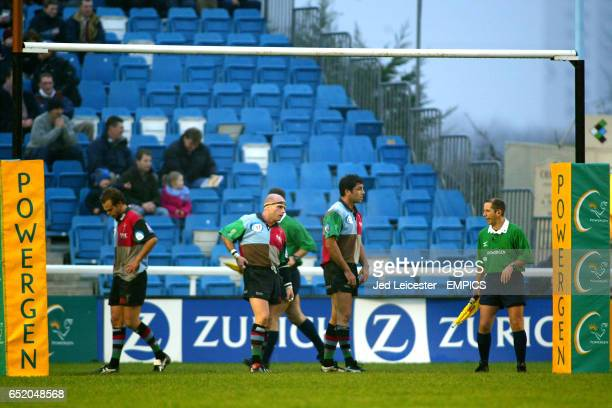 NEC Harlequins' players stand behind the posts for a Leeds Tykes conversion