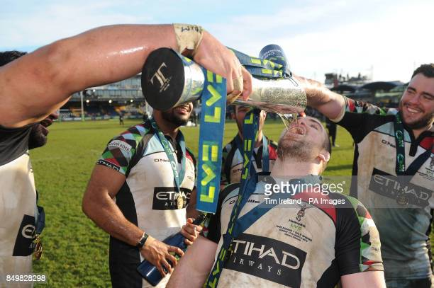 Harlequins' Rob Buchanan drinks from the trophy following the LV=Cup Final at Sixways Stadium Worcester