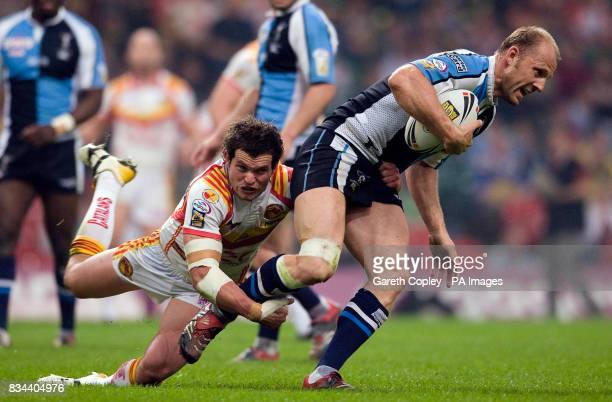 Harlequins' Scott Hill is tackled by Catalans' Clint Greenshields during the engage Super League match at the Millennium Stadium Cardiff