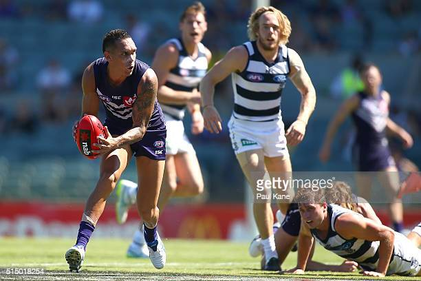 Harley Bennell of the Dockers gathers the ball during the NAB Challenge match between the Fremantle Dockers and the Geelong Cats at Domain Stadium on...