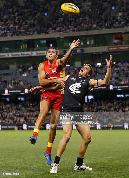 Harley Bennell of the Suns and Ed Curnow of the Blues compete for the ball during the 2015 AFL round thirteen match between the Carlton Blues and the...