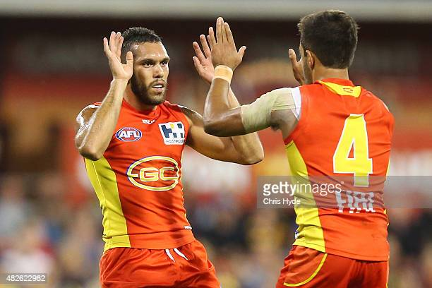Harley Bennell of the Suns celebrates a goal during the round 18 AFL match between the Gold Coast Suns and the West Coast Eagles at Metricon Stadium...