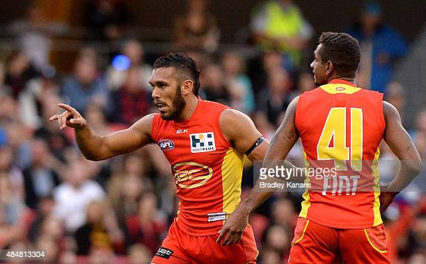 Harley Bennell of the Suns celebrates kicking a goal during the round 21 AFL match between the Gold Coast Suns and the Essendon Bombers at Metricon...