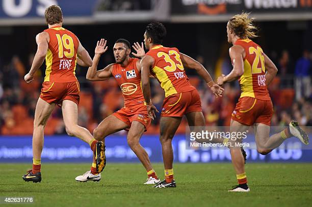Harley Bennell of the Suns celebrates with goal scorer Tom Lynch during the round 18 AFL match between the Gold Coast Suns and the West Coast Eagles...