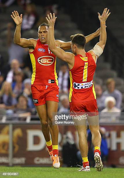 Harley Bennell of the Suns is congratulated by Jaeger O'Meara after kicking a goal during the round nine AFL match between the St Kilda Saints and...