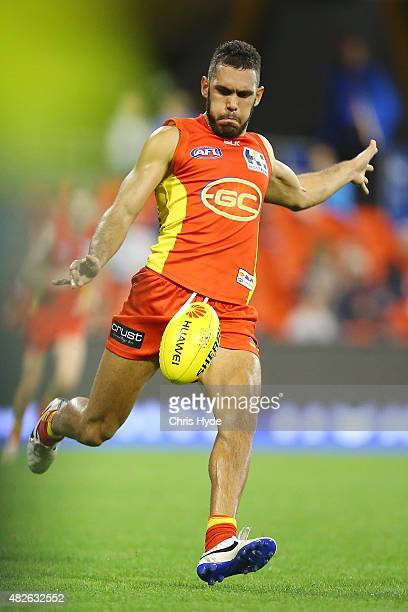 Harley Bennell of the Suns kicks during the round 18 AFL match between the Gold Coast Suns and the West Coast Eagles at Metricon Stadium on August 1...