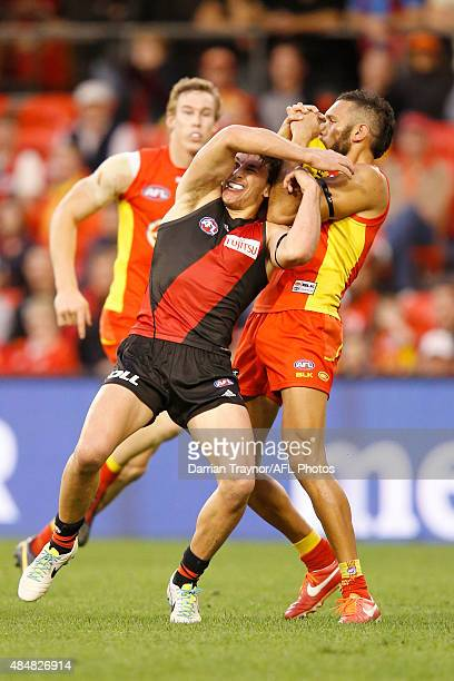 Harley Bennell of the Suns marks the ball over Mark Baguley of the Bombers during the round 21 AFL match between the Gold Coast Suns and the Essendon...