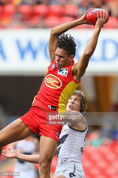 Harley Bennell of the Suns takes a mark during the round 23 AFL match between the Gold Coast Suns and the Greater Western Sydney Giants at Metricon...