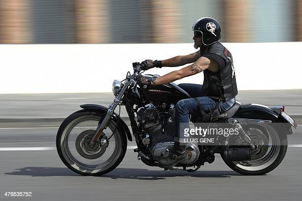 A Harley Davidson motorcyclist rides through the streets of Barcelona during the 'Great Flag Parade' of the Barcelona Harley Days 2015 on July 5 2015...
