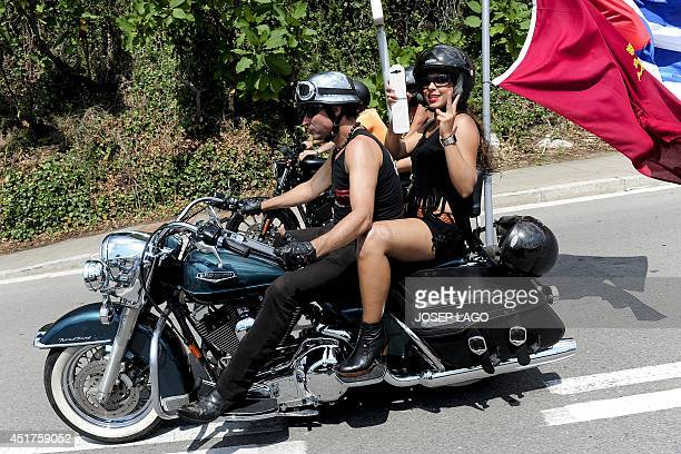 Harley Davidson motorcyclists ride through the streets of Barcelona during the 'Great Flag Parade' of the Barcelona Harley Days 2014 on July 6 2014...