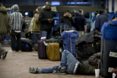 Harley Hayes tries to catch some shut eye amidst his luggage while he waits for news of his bus to Florida 200 plus passengers were stranded at the...