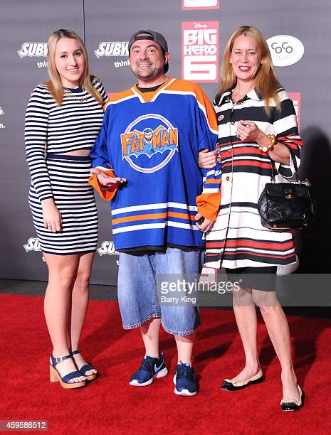 Harley Quinn Smith director Kevin Smith and actress Jennifer Schwalbach arrive at the Los Angeles premiere of 'Big Hero 6' held at the El Capitan...