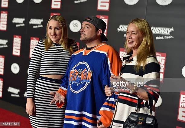 Harley Quinn Smith director Kevin Smith and actress Jennifer Schwalbach Smith attend the premiere of Disney's 'Big Hero 6' at the El Capitan Theatre...