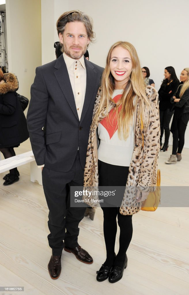 Harley Viera-Newton (R) attends the Vivienne Westwood Red Label show during London Fashion Week Fall/Winter 2013/14 at the Saatchi Gallery on February 17, 2013 in London, England.