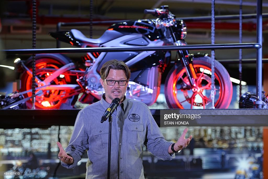 Harley-Davidson chief marketing officer Mark-Hans Richer, speaks in front of a Project LiveWire motorcycle, the company's first electric motorcycle, during a preview June 23, 2014 at a Harley-Davidson dealer in New York. AFP PHOTO/Stan HONDA