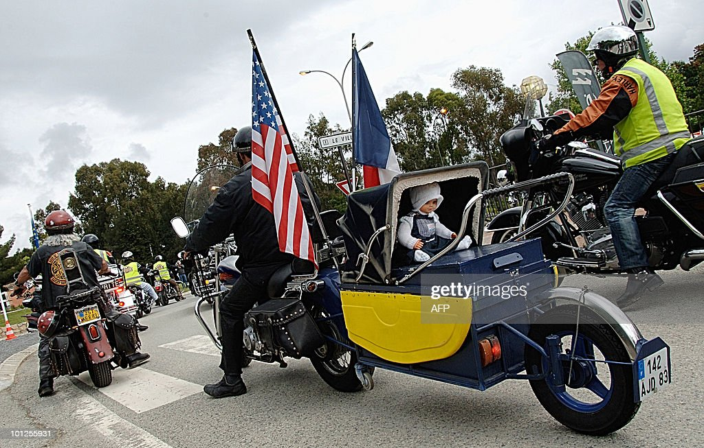 A Harley-Davidson pulls a baby carriage at the 2010 Harley-Davidson Euro Festival in Grimaud near Saint-Tropez, southeastern France, on May 8, 2010. Thousands of US legendary bikes are attending the 4th edition of this event scheduled from May 6 to 9.