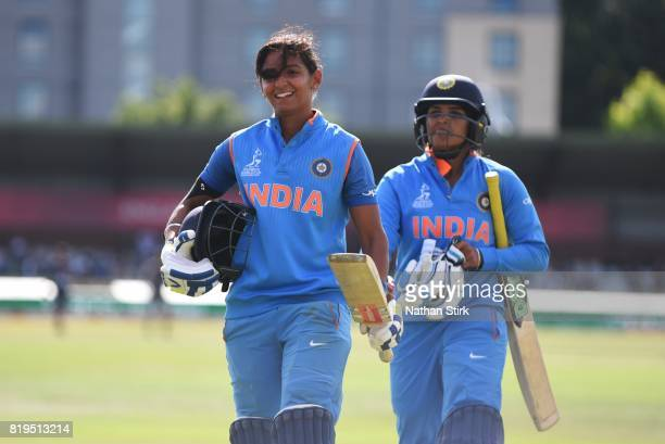 Harmanpreet Kaur and Veda Krishnamurthy of India walk of the pitch during the SemiFinal ICC Women's World Cup 2017 match between Australia and India...