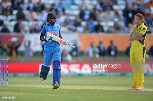 Harmanpreet Kaur of India and Megan Schutt of Australia looks on during the SemiFinal ICC Women's World Cup 2017 match between Australia and India at...
