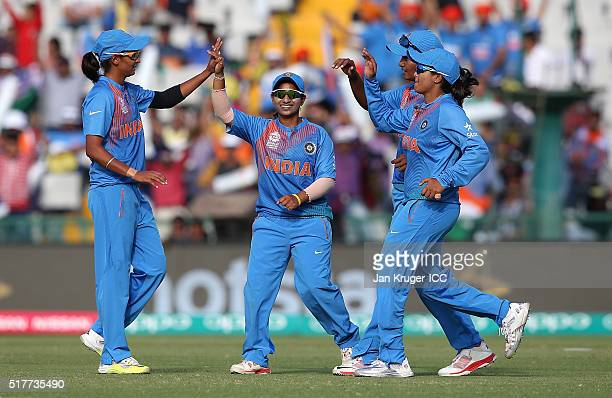 Harmanpreet Kaur of India celebrates her four wicket haul with team mates during the Women's ICC World Twenty20 India 2016 match between West Indies...