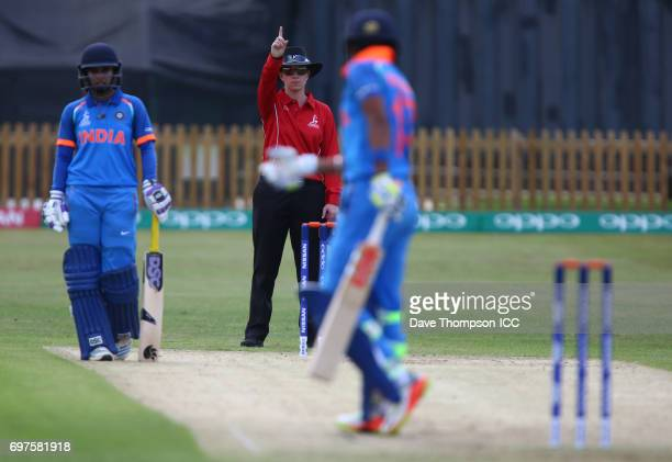 Harmanpreet Kaur of India is given out LBW by umpire Claire Polosak during the ICC Women's World Cup warm up match between India and New Zealand at...