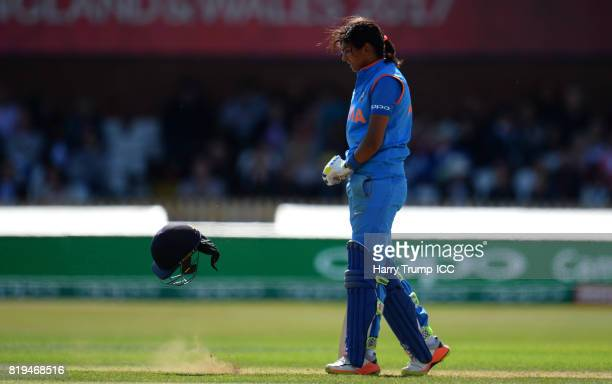 Harmanpreet Kaur of India reacts as she throws her helmet to the floor during the ICC Women's World Cup 2017 match between Australia and India at The...