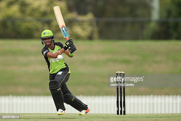 Harmanpreet Kaur of the Thunder bats during the WBBL match between the Melbourne Renegades and Sydney Thunder at Blacktown International Sportspark...