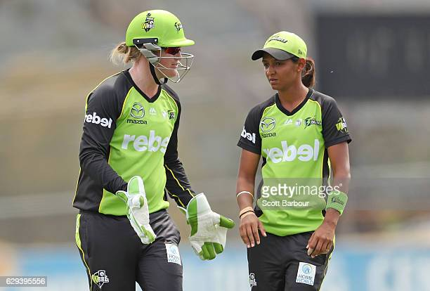 Harmanpreet Kaur of the Thunder is congratulated by her teammates after dismissing Jess Cameron of the Stars during the Women's Big Bash League match...