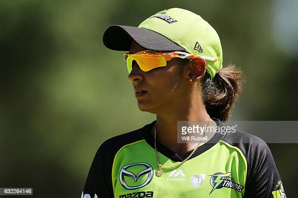 Harmanpreet Kaur of the Thunder looks on during the Women's Big Bash League match between the Sydney Thunder and the Perth Scorchers at Lilac Hill on...