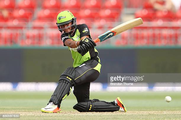 Harmanpreet Kaur of the Thunder sweeps during the WBBL match between the Thunder and Sixers at Spotless Stadium on December 28 2016 in Sydney...