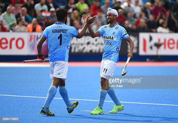 Harmanpreet Singh of India celebrates his goal with Mandeep Singh during day two of the FIH Men's Hero Hockey Champions Trophy 2016 match between...