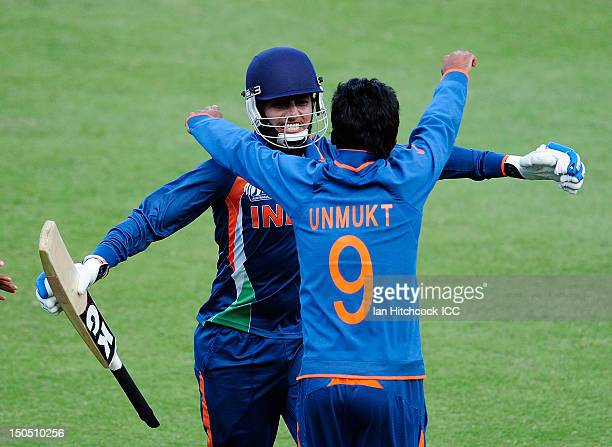 Harmeet Singh of India is embraced by Unmukt Chand of India after scoring the winning runs during the ICC U19 Cricket World Cup 2012 Quarter Final...