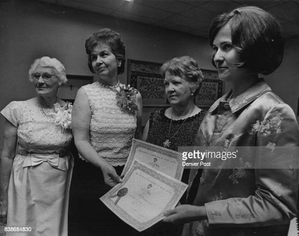 Harmonious Event at Music Club Banquet Awards from National Federation of Music Clubs were presented Wednesday to Mrs Carol McMarrough far right...