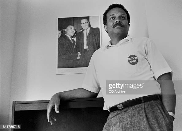 Harold Brazil DDC Council Member standing near his poster of Martin Luther King Jr and Malcolm X Febuary 6 1990