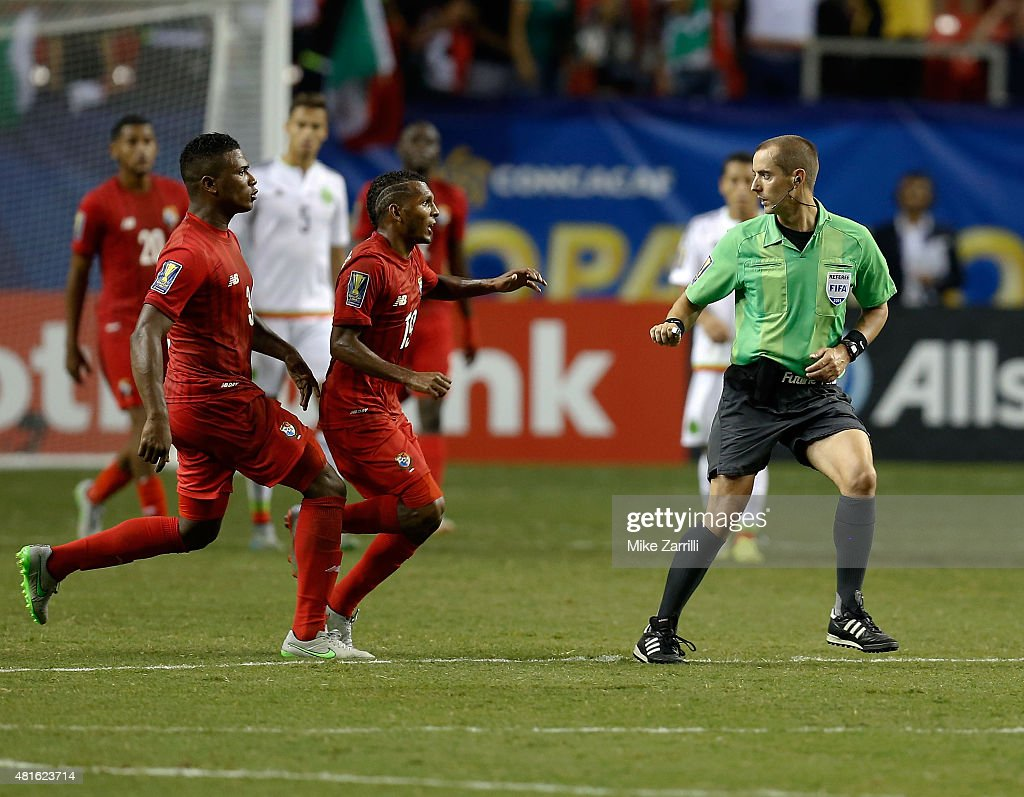 Harold Cummings #3 and Alberto Quintero #19 of Panama chase head referee Mark Geiger at the end of the 2015 CONCACAF semifinal match against Mexico at Georgia Dome on July 22, 2015 in Atlanta, Georgia.