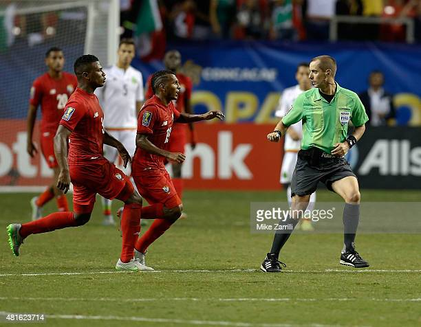 Harold Cummings and Alberto Quintero of Panama chase head referee Mark Geiger at the end of the 2015 CONCACAF semifinal match against Mexico at...