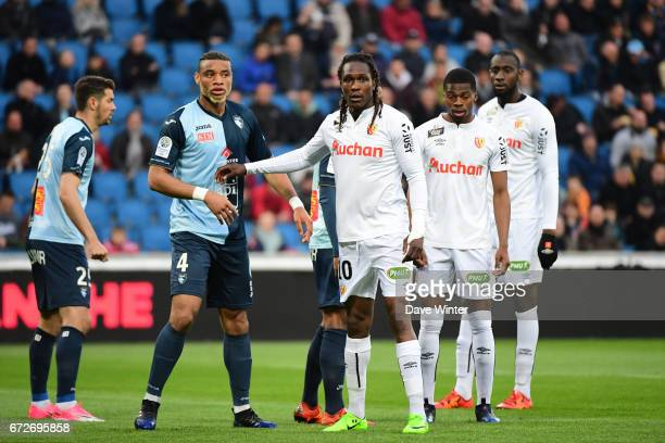 Harold Moukoudi of Le Havre and Habib Habibou of Lens wait for a corner during the Ligue 2 match between Le Havre AC and Racing Club de Lens on April...