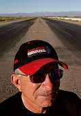 – Harold Owens vice president of Dust Devils Auto Club stands at the starting line of the drag strip at the Inyokern Airport Drag racing has been a...