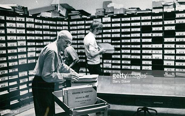 VOTERS' NAMES GO BACK INTO THE RACKS AS BALLOTING ENDS Harold Pletsch an employe of the Denver Election Commission sorts precinct records for...