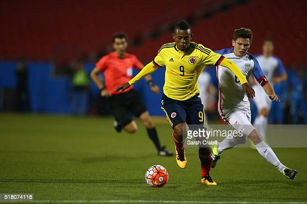Harold Preciado of Colombia dribbles the ball against the US Under23 Men's National Team during the first half of the 2016 CONCACAF Olympic...
