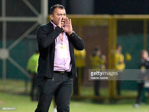 Harold Rivera coach of Patriotas FC gives instructions to his players during a match between Patriotas FC and Millonarios as part of Liga Aguila II...