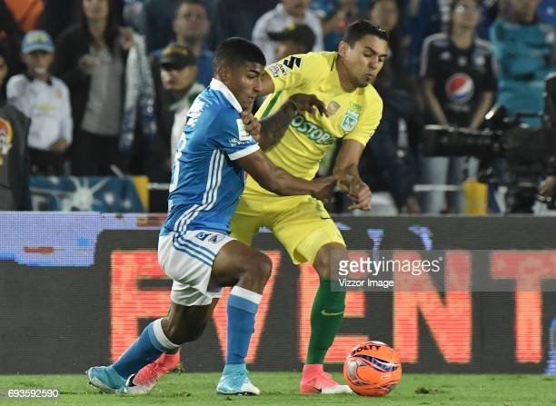 Harold Santiago Mosquera of Millonarios fights for the ball with Daniel Bocanegra of Atletico Nacional during the Semi Finals first leg match between...