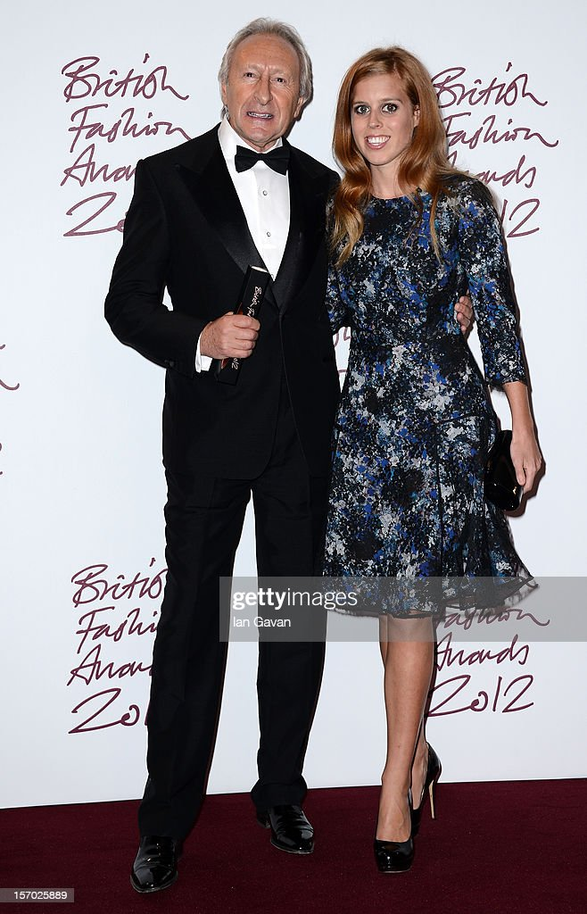 Harold Tillman CBE, winner of the Special Recognition award and Princess Beatrice pose in the awards room at the British Fashion Awards 2012 at The Savoy Hotel on November 27, 2012 in London, England.