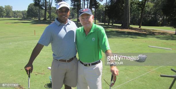 Harold Varner III and golf coach Bruce Sudderth pose for a portrait at Gastonia Country Club September 2015 in Gastonia NC