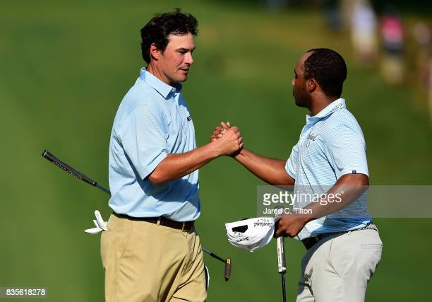 Harold Varner III and Johnson Wagner shake hands after the third round of the Wyndham Championship at Sedgefield Country Club on August 19 2017 in...