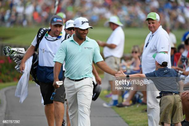 Harold Varner III greets fans on the 17th hole during the third round of THE PLAYERS Championship on THE PLAYERS Stadium Course at TPC Sawgrass on...