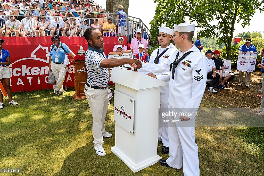 Harold Varner III greets members of the Armed Forces on the first hole tee box during the final round of the Quicken Loans National at Congressional Country Club (Blue) on June 26, 2016 in Bethesda, Maryland.